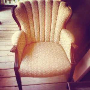 big channel back chair with old fabric before renewal